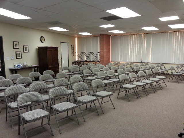 Large Classroom set up for event with 70 attendees in audience style seating.